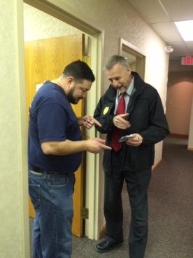 BWC Special Agent in Charge Doug Fisher (right), of SID's Health Care Provider Team, conducts a search warrant with Digital Forensic's Manager Joe Lopez in Northeast Ohio earlier this year.